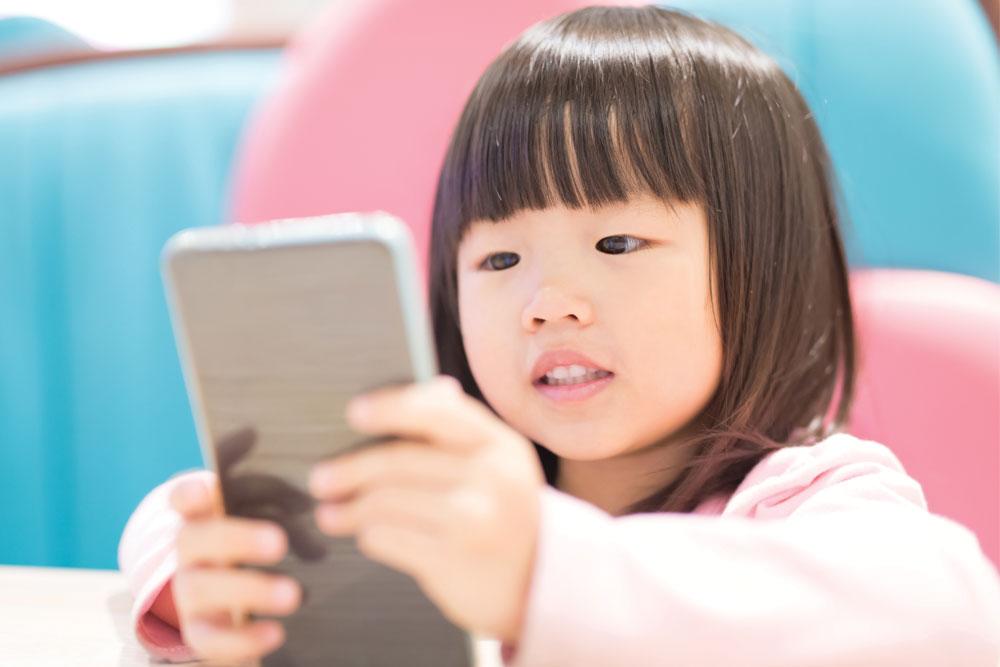 children smartphones girl watching screen